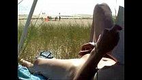 Horny nude wife masturbates at public beach