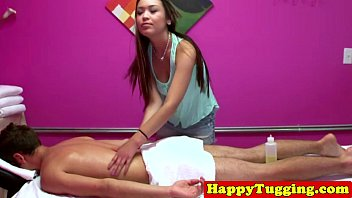 Inked asian masseuse tugging hard cock