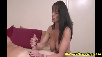 Busty stepmom wanking a cock dry over boobs