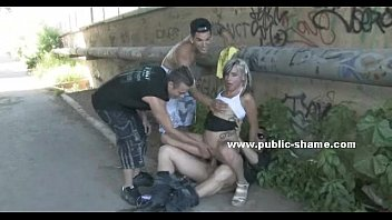 Whore tied and masked in public sex