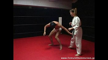 Masked slave suffers b. beating by mistress inside the ring