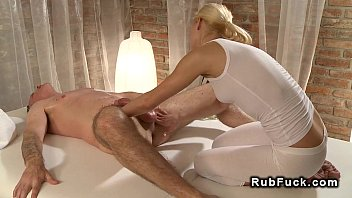 Blonde tight masseuse giving cock massage