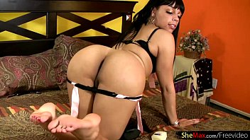 Black shemale beauty inserts sex toy in tight anal and jerks