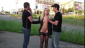 A blonde cutie is fucked hard in PUBLIC by 2 guys with big dicks