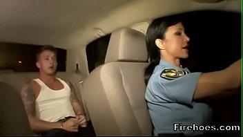 Female police officer fucks suspect in car
