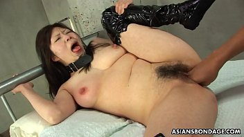 Collared Asian endures rough fingering and a nipple t.