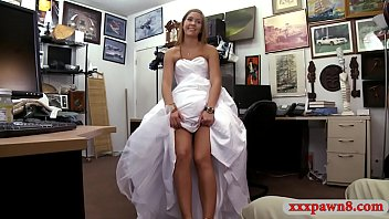 Woman in wed dress boned at the pawnshop