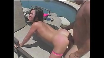Brunette Ashley Blue plays with a dildo by the pool then stud comes to fuck her