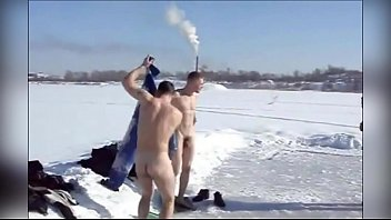 Russian guys are swimming naked in an ice-hole in winter