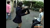 A young Asian girl in a school uniform is running al from