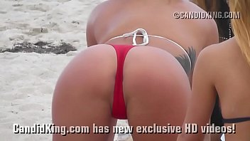 Sexy teen on the beach showing tan thong covered ass in public!
