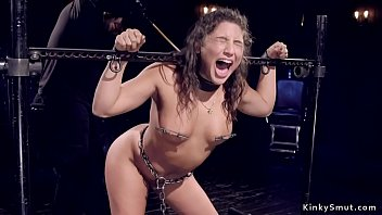 Hot brunette gets whipped in bondage