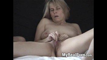 Older blonde masturbates