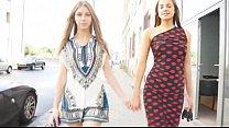 Maria Ryabushkina (aka Tara) and Abby walk through the town