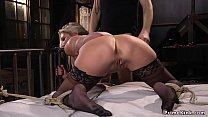 Captor flogs and vibrates busty blonde