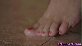 Fetish babe showers feet for cumshot