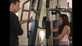 Gym instructor helps young girl Kitty with red hair and small tits to get a handle on her new device for physical exercises