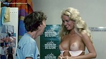 Cindy Manion takes off her bikini top and exposes her tanlined boobs