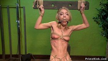 Slim blonde is anal toyed in hogtie