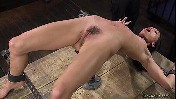 Ebony slave in device bondage whipped