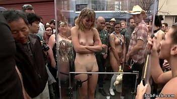 Blonde slut is caned outdoors at fair