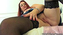 Busty mature Devon Breeze pleases her fanny with fingers