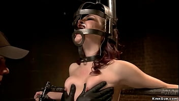 Gagged slave in extreme device bondage