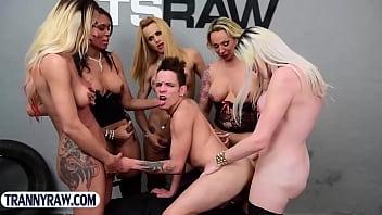 Guy gangbang fucked by a group of big cock latina trannies