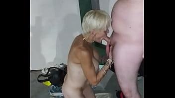 Hooker milf gets naked in public for a public blowjob