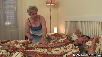 Horny mother in law wakes him up for doggy-fuck