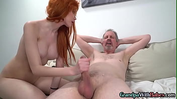 Busty ginger sucking older man before riding