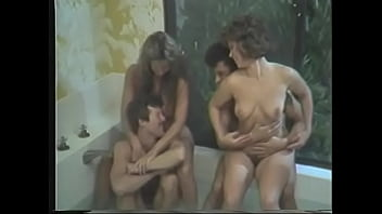 Two lusty friends invited charming busty neighbour Mindy Rae to taste their hard schloengs after swingers party when their wives went away to spread gossip 5 min
