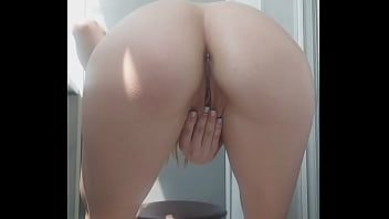 Gambling girl takes off her shorts