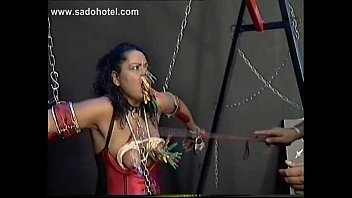 Tied up slave with alot of clamps on her face and tongue got spanked and spit in her face by master