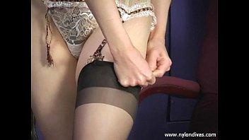Putting on lingerie and black nylon stockings