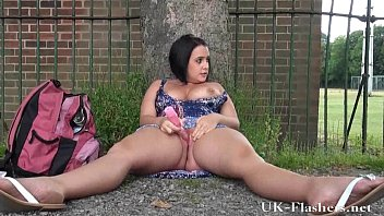 Outdoor masturbation of sexy amateur milf showing shaved pussy in public and fla