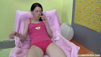 Brunette teen plays with lollipop