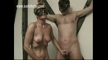 Horny slave plays with her own pussy and mastrubates cock of tied guy while she gets spanked on her