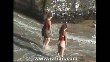 Girl having fun bottomless on a nudist beach