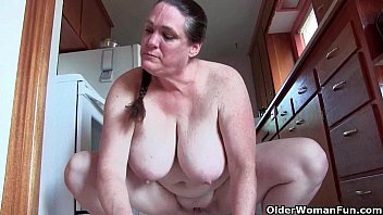 Granny with big tits cleaning the kitchen naked