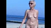 Cute hot granny fully naked at beach. Public nudity