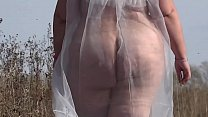 Exhibitionism in Russian. Almost naked beautiful BBW with a big butt walks outdoors on a public road. Fetish.