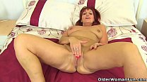 British milf Beau Diamonds plays with her nyloned wet fanny