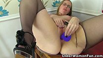 British milf Sammie gets busy with a dildo