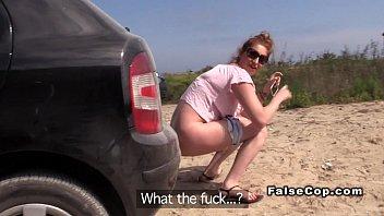 Fake cop bangs brunette near the beach