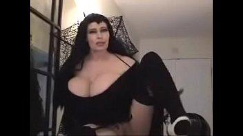 teddi barrett big boob in black dress on stair